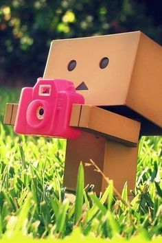 cute robot taking picture with pink camera