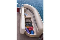 Starboard bow lounge seating w/storage & trash receptacle underneath http://www.exclusiveautomarine.com/product/party-barge-18-dlx