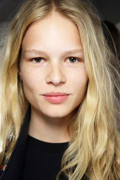 Meet German-born Anna Ewers, a bonafide babe who's been stirring things up at New York Fashion Week. With a peaches 'n' cream complexion and bold-yet-soft features, we're going to call her a mythical hybrid of Heath Ledger, Brigitte Bardot and Claudia Schiffer. Herein lies pictorial evidence as to why she's on our radar: Observe above the faultless skin (#unfair). Here she is before opening for Alexander Wang.  Lock and key at Rodarte.  Lurking backstage at Derek Lam, looking suitably…