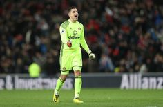 Vito Mannone of Sunderland celebrates as his team draw level for the second time during the Premier League match between Sunderland and Liverpool at Stadium of Light on January 2, 2017 in Sunderland, England.