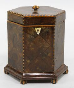 Unusual Georgian Oyster-Walnut Hexagonal Tea Caddy, barber pole inlaid feet.  From Liveauctioneers