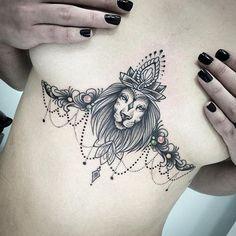 Lion sternum / underboob tattoo