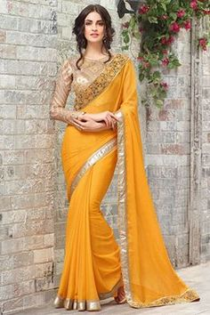 Creating a perfect story of premium dressing, this bright yellow saree will surely steal hearts. Latest Indian Saree, Indian Sarees Online, Indian Dresses, Indian Outfits, Indian Clothes, Designer Silk Sarees, Designer Dresses, Modern Saree, Saree Trends