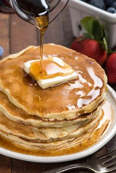 pancakes with syrup on white plate