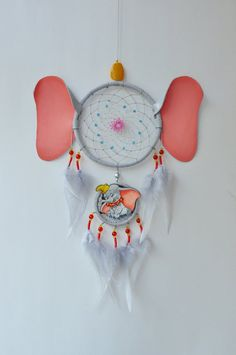 DREAM CATCHER DUMBOO  Exclusive wall hanging inspired by the cartoon character. This dreamcatcher will be a good birthday gift for a fan. Also, it will a great addition to the baby nursery, childrens room, and kids room decor. In the center of the dream catcher, there is a little elephant which is