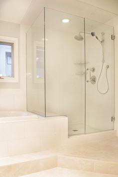 European-Style Glass Shower Door. White Tile on floor and walls.