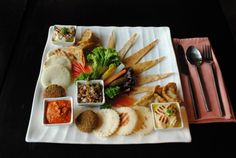 #Veg #Mezze #Platter: Deep fried patties of chickpea served pita bread, Lebanese pickle and hummus.