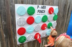 Power Punch Wall. It's a tri-fold white board covered in hot glued paper bowls that I stuffed with a prize then covered in 2 layers of tissue paper.  Each child got to choose their bowl to punch and received the prize inside. Power Ranger Birthday, Power Ranger Party, Batman Birthday, Avengers Birthday, Superhero Birthday Party, Spider Man Birthday, Spiderman Birthday Ideas, Spiderman Theme Party, 3rd Birthday Parties
