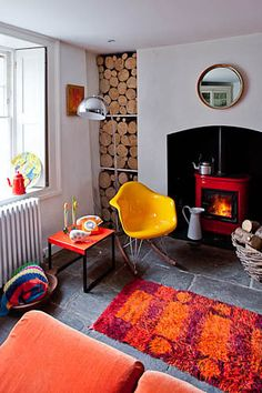 Cozy!  Would love to own that yellow rocking chair :)