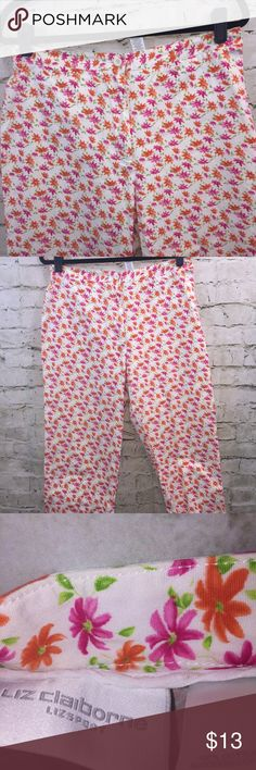 """Liz Claiborne Lizsport Capri Pant Sz 14 Liz Claiborne Lizsport White W/Pink and Orange Flowers Capri Pant Light Weight Womens Size 14 EUC  Made in Philippines  Material - 100% Cotton  Measurements - Waist 16"""" (flat lay side seam to side seam), Inseam 24 1/2""""  Check out my other listings! **Offers Welcome** ***Bundle = 15% off Please let me know if you have any questions! Sorry, no trades The capris come from a smoke free home Liz Claiborne Pants Capris"""