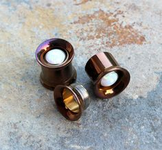 SOLD AS PAIR  Pair of Implant Grade Surgical Steel Bronze Anodize Double Flare Internally Threaded Tunnel Plugs With Inlay White Fire Opal  NOTE : Please UNSCREW tunnels upside down Available sizes : 0G-8mm, 00G-10mm, 7/16-11mm, 1/2-13mm, 9/16-14mm, 5/8-16mm, Sizes mention are measure from middle part the bottom part is internally threaded for easy wear  Nicely Wrapped in gift box