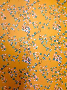 Yellow wrapping paper with wandering flowers and leaves.