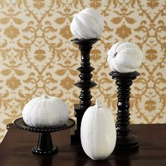 These pumpkins are painted white and covered in glitter. More #Halloween ideas: http://www.bhg.com/halloween/indoor-decorating/quick-clever-halloween-centerpieces/#page=1