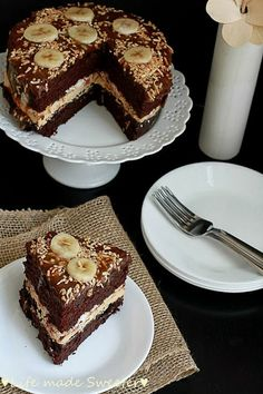 Chocolate Banana Cake with Salted Caramel Frosting - A moist, chocolatey cake filled with sliced bananas, toasted coconut and salted caramel frosting. Smothered with chocolate ganache and salted caramel sauce, this decadent cake is sure to impress. @LifeMadeSweeter