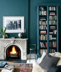 The Designer's Small Space Trick that Makes Any Room Look Larger: How to make bookcases look built in (even if you're renting)? Paint them the same color as the wall.