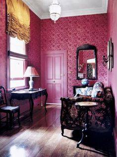 love the pink, the hardwood floor, and the sheer daintiness of this room. i would have alone/girl time here