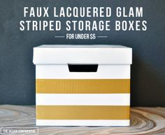 Label on the colored.duct tape - Easy DIY Faux Lacquer and Glam Striped Storage Boxes for Under $5 | The Design Confidential-TOY STORAGE