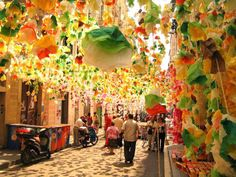 Gràcia Street party in Barcelona. Gràcia is a Barcelona barri where ONCE a year celebrates his Festa Major and all streets get dressed up with all sorts with live music and meals for all .