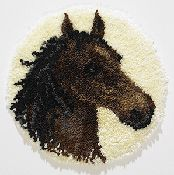 """Off to the races with our 18"""" Round Horse Decorator Rug Kit. Easy to hook and such fun to do. Our kit comes complete with easy to follow full color graph, instruction sheet, Latch hook blue lined canvas (for easy counting and perfect results every time.), 100% acrylic pre-cut rug yarn and how to latch hook instructions."""