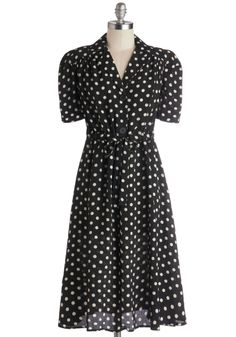 According to Lesson Plan Dress. While gracing the teachers lounge with the off-white polka dots and oversized buttons of this black shirt dress, you share how your first class was a success. #black #modcloth