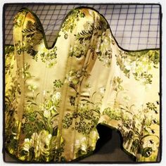 """I love this pattern-matched corset by Puimond; not only the richness of the fabric itself, but the way the vines flow so gracefully over the corset. This photo was captioned """"A taste of spring"""" and I think it captures the corset perfectly."""