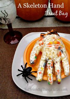 A Skeleton Hand Treat Bag Craft. Perfect for Halloween parties, Hotel Transylvania birthday parties, and more! Fill a glove full of goodies! So much fun!