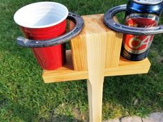 Set of 2, Portable horseshoe, corn hole drink stand. Beautifully handmade specifically for the backyard game fan. Approximately 32 tall. Can be used on a hard surface or lawn area. Comes with a zinc stabilization rod for non-hard surfaces. This great gift item(for yourself maybe?) keeps your precious drink stable, dirt free and most importantly close at hand. Cheers!  VIEW ALL OF MY 5-STAR REVIEWS: ★★★★★ https://www.etsy.com/your/shops/MRWoodCrafting/reviews   **...