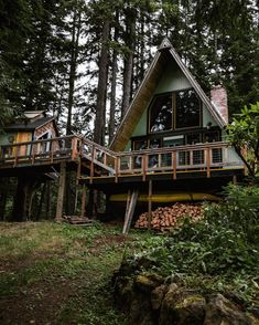 Treehouse addition to an A-frame, linked by a porch