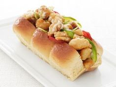 Fried-Catfish Rolls : Toss fried catfish with spiced mayonnaise and serve on thick potato rolls. Garnish with tomato, pickles and celery.