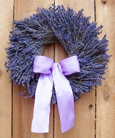 How to Make a Lavender Wreath (and a bunch of other crafts with lavender). Make this wreath with a wire coat hanger, twine, and lavender flowers. #Lavender #ad