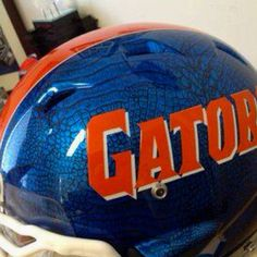 Not sure what the technical term is for this process but that metallic snake skin texture is killer. I love the new helmet design. New Football Helmet, Football Helmet Design, College Football Helmets, New Helmet, Helmet Logo, Sports Helmet, Football Uniforms, Florida Gators Football, Ohio State Football