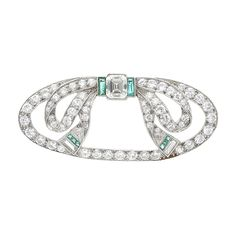 Art Deco Platinum, Diamond and Emerald Brooch  One cut-cornered step-cut emerald-cut diamond ap. .45 ct., 63 old European & single-cut diamonds ap. 1.70 cts., c. 1920, ap. 5.4 dwts.