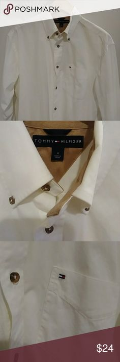 Tommy Hilfiger Vintage Tommy Hilfiger button down shirt vintage (M). This vintage shirt has no issues. No stains no rips all of the buttons are secured. Wood grain look for the buttons. Suede feeling material around the inside of collar, as seen in the last pic. This shirt is great for office or casual play.Overall this shirt is in euc, & a staple for any guys wardrobe. Tommy Hilfiger Shirts Casual Button Down Shirts