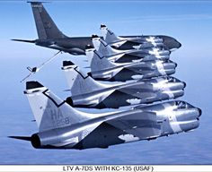 A formation of USAF LTV A-7DS Corsairs and a Boeing KC-135 Stratotanker.