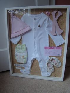 Shadow box- first sleeper, a leftover newborn diaper, hospital band, etc.