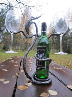 Hand forged Bacchus bottle- and glass holder.