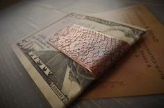 Snake skin money clip handmade in solid copper. Etched with a beautiful natural snake skin pattern. Looks beautiful and has an amazing feel too.