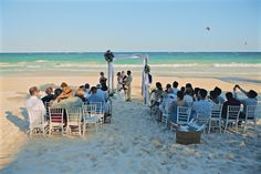 The sun and the sea as a background for the white ceremony on the beach - Emily & Rishi's destination wedding in Tulum