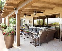 Covered Patios--Roofline Details The execution of a covered patio's roof can do much to enhance its level of intimacy. Here, regular placement of beams -- their ends gently carved -- offer a soothing visual ceiling to the rustic-leaning spot. If your covered patio is on the same plane as another paved space or the landscape, use oversize planters -- here, hammered copper -- to create a transition from one zone to the next.