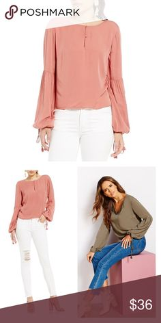 """gianni bini • stacy mauve pink bell sleeve blouse New with tags. Will fit M as well😄Gorgeous! The perfect fall transition piece - and stay on trend with its beautiful long bell sleeves. This blouse features: v-neckline long sleeves cropped length pullover construction tassel trim rayon dry clean. UA to UA 21"""", length 20.5"""". Gianni Bini Tops Blouses"""