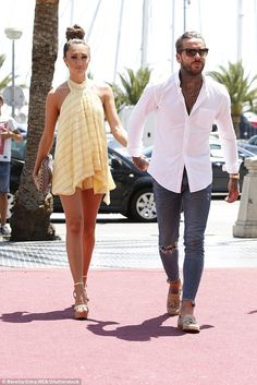 Going strong:Megan Mckenna and Peter Wicks looked more loved-up than ever as they stepped out hand-in-hand in Mallorca on Wednesday