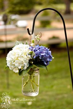 Flowers - Hydrangeas,for an outdoor reception i would put tea lites in the jar and lite them up at night. @Katie Schmeltzer Schmeltzer Potts  another cute ceremony idea. my mom has those sheppards hooks you could borrow im sure if i ask her.
