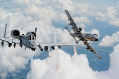 Capts. Andrew Glowa left and William Piepenbring launch flares from two A-10C Thunderbolt IIs [2048 x 1365]. wallpaper/ background for iPad mini/ air/ 2 / pro/ laptop @dquocbuu