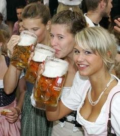 I want to go to Oktoberfest in Munich, wear a dirndl and drink a beer as big as my head!  : )