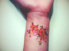 Floral tattoo in wrist i would never get it but it's really pretty