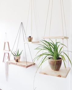 Unique folk inspired wall shelf. Handmade from wood and rope. Suspends from from ceiling or wall. Perfect for plants or smaller books...great in