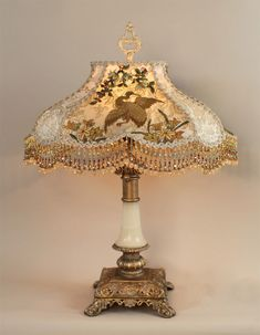 Stately, antique table lamp with alabaster accents holds a Chinoiserie inspired lampshade layered with vintage and antique fabrics. The Chinoiserie Crane shade is hand dyed in soft tones of ivory, cream and pale dusty blue and is overlaid in a number of a Antique Table Lamps, Old Lamps, Antique Chandelier, Chandelier Lamp, Vintage Lamps, Chandeliers, Ceiling Lamps, Pendant Lamps, Pendant Lights