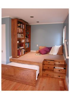 Nook built into larger room, Multilevel platform, pullout trundle bed, storage drawers.