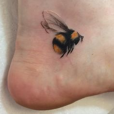 Delicate bumble bee foot tattoo
