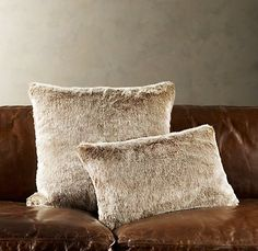 Naturalesque in color for faux fur pillows on bed and chaise